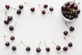top view of sweet and whole cherries on bowl on white background