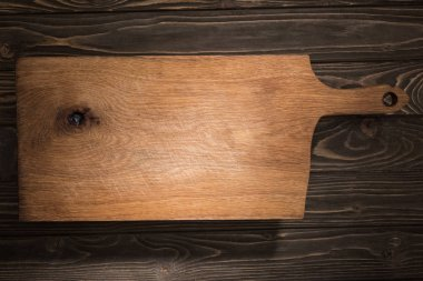 Top view of wooden cutting board on brown table stock vector