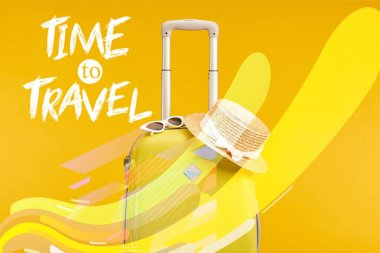 Yellow colorful travel bag with sunglasses and straw hat isolated on yellow with time to travel illustration stock vector