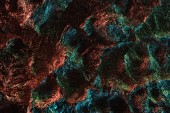 abstract background of textured crumpled foil with colorful lighting