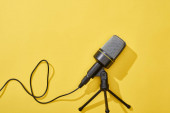 Photo top view of microphone on bright and colorful background