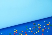 sweet candies on bright and colorful background with copy space