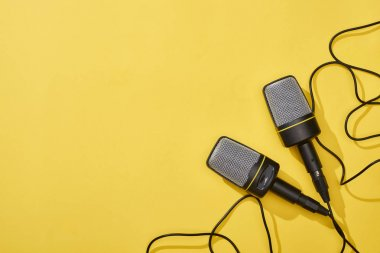 top view of microphones on bright and colorful background with copy space