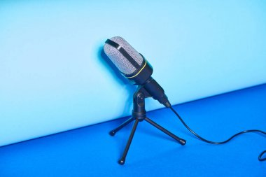 black microphone on bright and colorful background with copy space