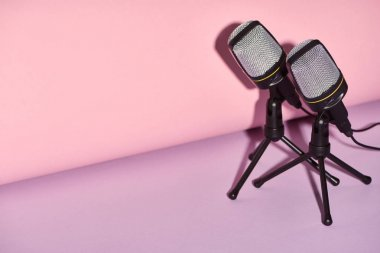 black microphones on bright and colorful background with copy space