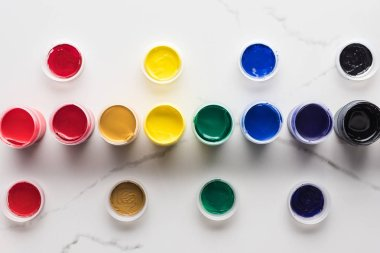Flat lay with multicolored gouache paints on marble surface stock vector