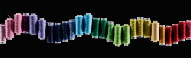 panoramic shot of bright and colorful threads isolated on black