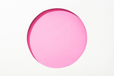 Cut out round hole in white paper on pink colorful background stock vector
