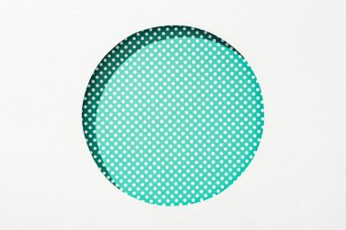 Cut out round hole in white paper on green dotted background stock vector
