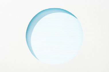 Cut out round hole in white paper on striped blue background stock vector