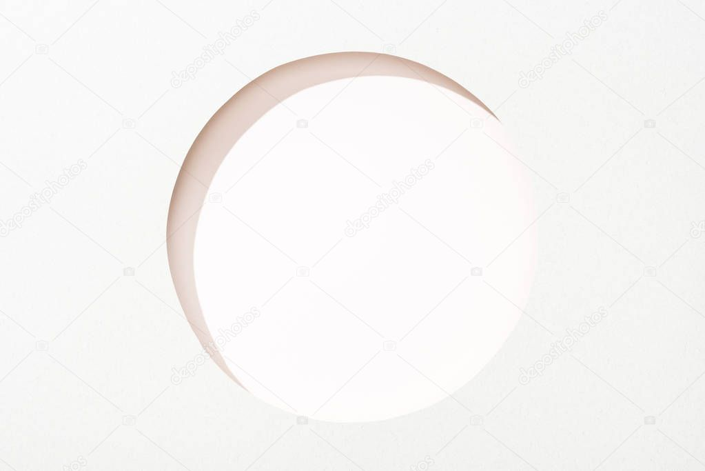 Cut out round hole in white paper on white background stock vector