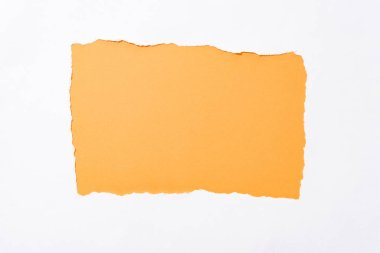 Orange colorful background in white torn paper hole stock vector