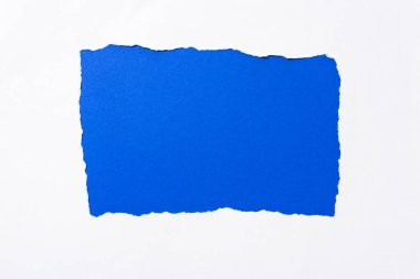 Bright electric blue colorful background in white torn paper hole stock vector