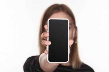 Selective focus of victim of cyberbullying showing smartphone with blank screen isolated on white stock vector