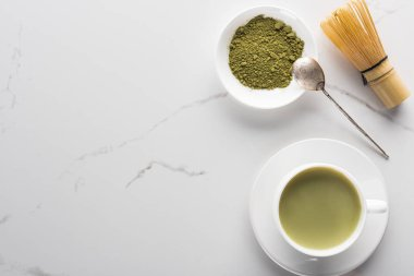 top view of traditional green matcha tea on white table