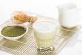 green matcha tea with milk on bamboo mat