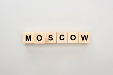 top view of wooden blocks with Moscow lettering on white background