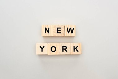 top view of wooden blocks with New York lettering on white background