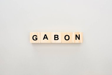 top view of wooden blocks with Gabon lettering on white background