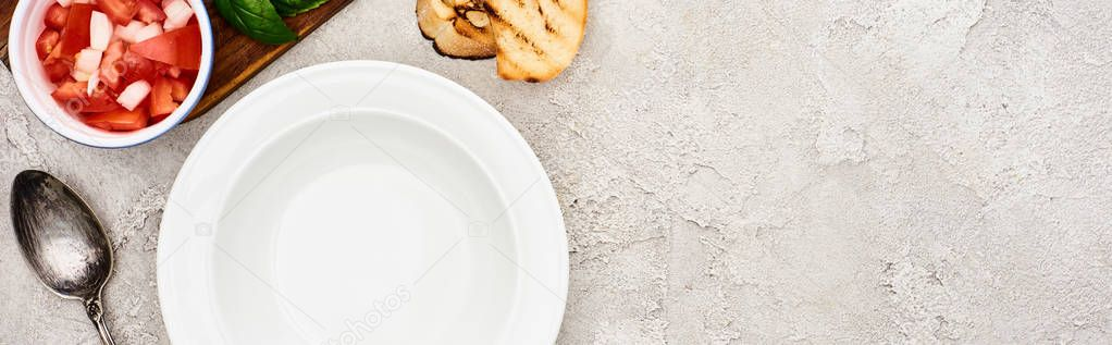 Top view of empty plate near wooden cutting board with fresh ingredients, panoramic shot stock vector