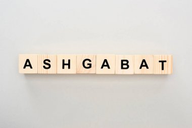 top view of wooden blocks with Ashgabat lettering on grey background