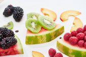 Fotografie delicious dessert with watermelon, kiwi and berries on white background