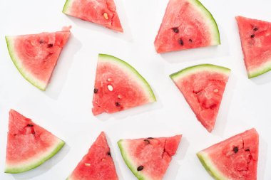 Top view of organic juicy watermelon slices on white background stock vector