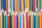 Two lines of different sizes sharpened color pencils