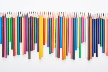 Line of different sizes color pencils isolated on white stock vector