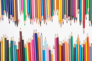 Two lines of different sizes color pencils isolated on white stock vector