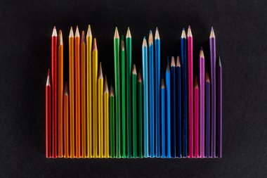 Rainbow spectrum made with color pencils isolated on black stock vector