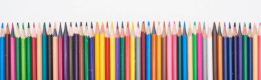 Panoramic shot of straight line of color pencils isolated on white stock vector