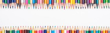 Panoramic shot of color pencils isolated on white with copy space