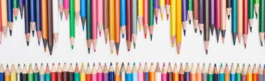 Panoramic shot of rows of sharpened color pencils stock vector