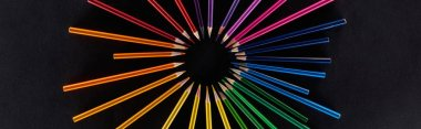 Panoramic shot of circular rainbow spectrum made with color pencils isolated on black stock vector