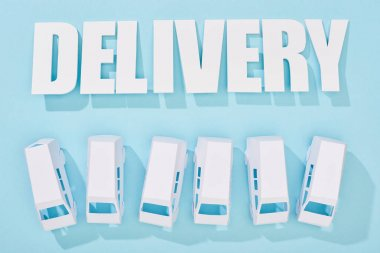 Delivery inscription with shadows near mini vans on blue background stock vector