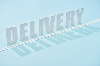 White delivery inscription with shadow and double line on blue background with copy space stock vector