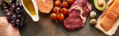 Fotografie Panoramic shot of raw meat, poultry, fish near quail eggs, grape, tomatoes, avocado and olive oil
