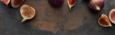 Panoramic shot of ripe fresh whole and cut figs on stone textured background stock vector