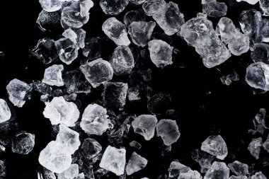 top view of clear frozen ice cubes isolated on black