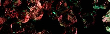 panoramic shot of clear ice cubes with red and green lighting isolated on black