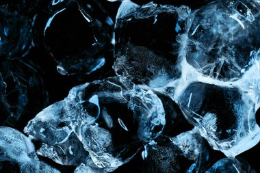 Frozen transparent ice cubes with blue lighting isolated on black stock vector
