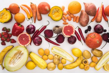 top view of assorted autumn vegetables, citruses, fruits and berries on white background