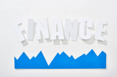 Fotografie top view of finance inscription with blue statistic graph on white background