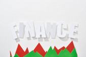 Fotografie top view of finance inscription with green and red statistic graphs on white background