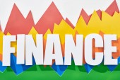 Fotografie top view of finance inscription above multicolor statistic graphs on white background