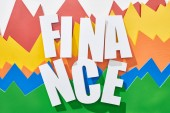 Fotografie top view of finance inscription on white background with multicolor statistic graphs