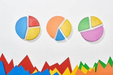 Top view of multicolor statistic graphs and pie charts on white background stock vector