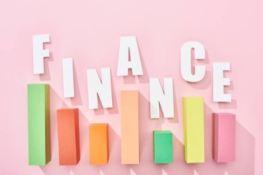 Top view of finance inscription with color graph on pink background stock vector