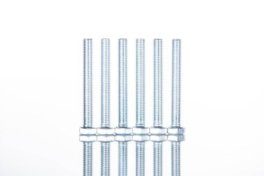 Close up view of shiny long bolts isolated on white with copy space stock vector